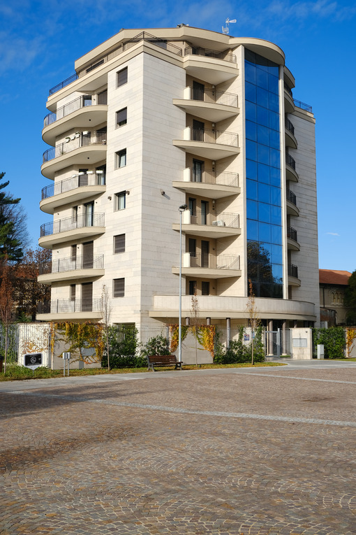 Modern tower building for residential apartments in the city center of Busto Arsizio. Marble cladding and porphyry floor by Trentino. - MyVideoimage.com