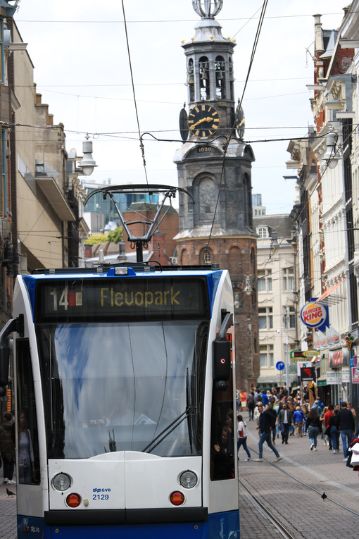 Modern tram in the center of Amsterdam, front view with the towe - MyVideoimage.com