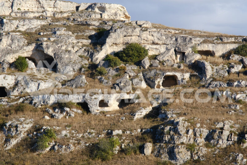 Mountain in front of the city of Matera in Italy. Caves used as dwellings in prehistoric times - MyVideoimage.com