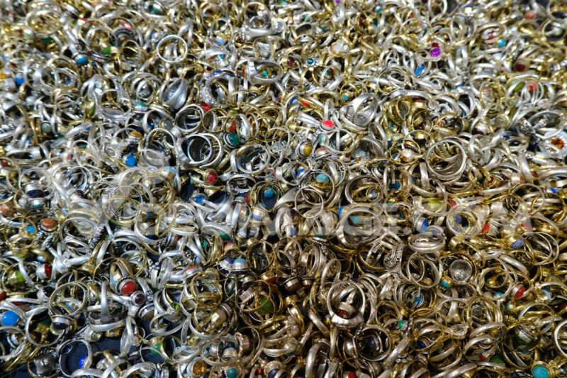 Mountain of silver rings with stones. - MyVideoimage.com