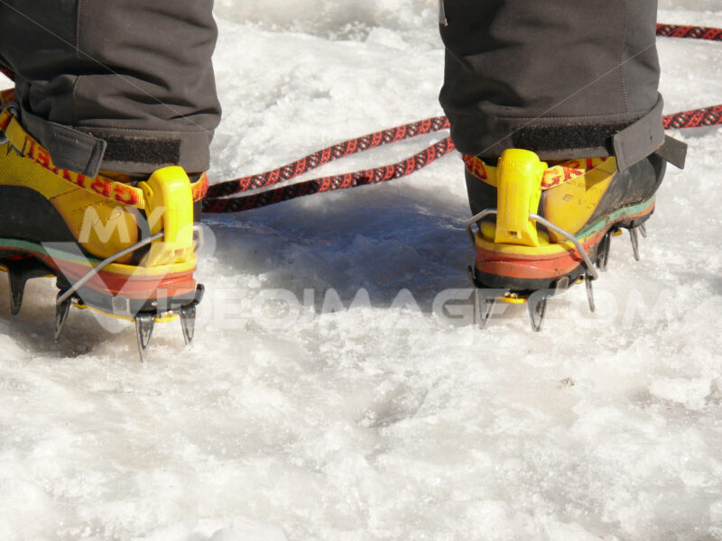 Mountaineer with crampons - MyVideoimage.com