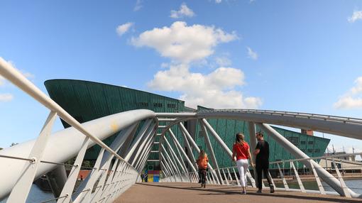 Nemo and steel pedestrian bridge over a canal in Amsterdam. In t - MyVideoimage.com