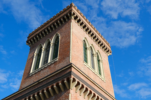 Neo-Gothic tower. Textile Museum in Busto Arsizio. Neo-Gothic construction in terracotta bricks with turrets and ogival windows. - MyVideoimage.com