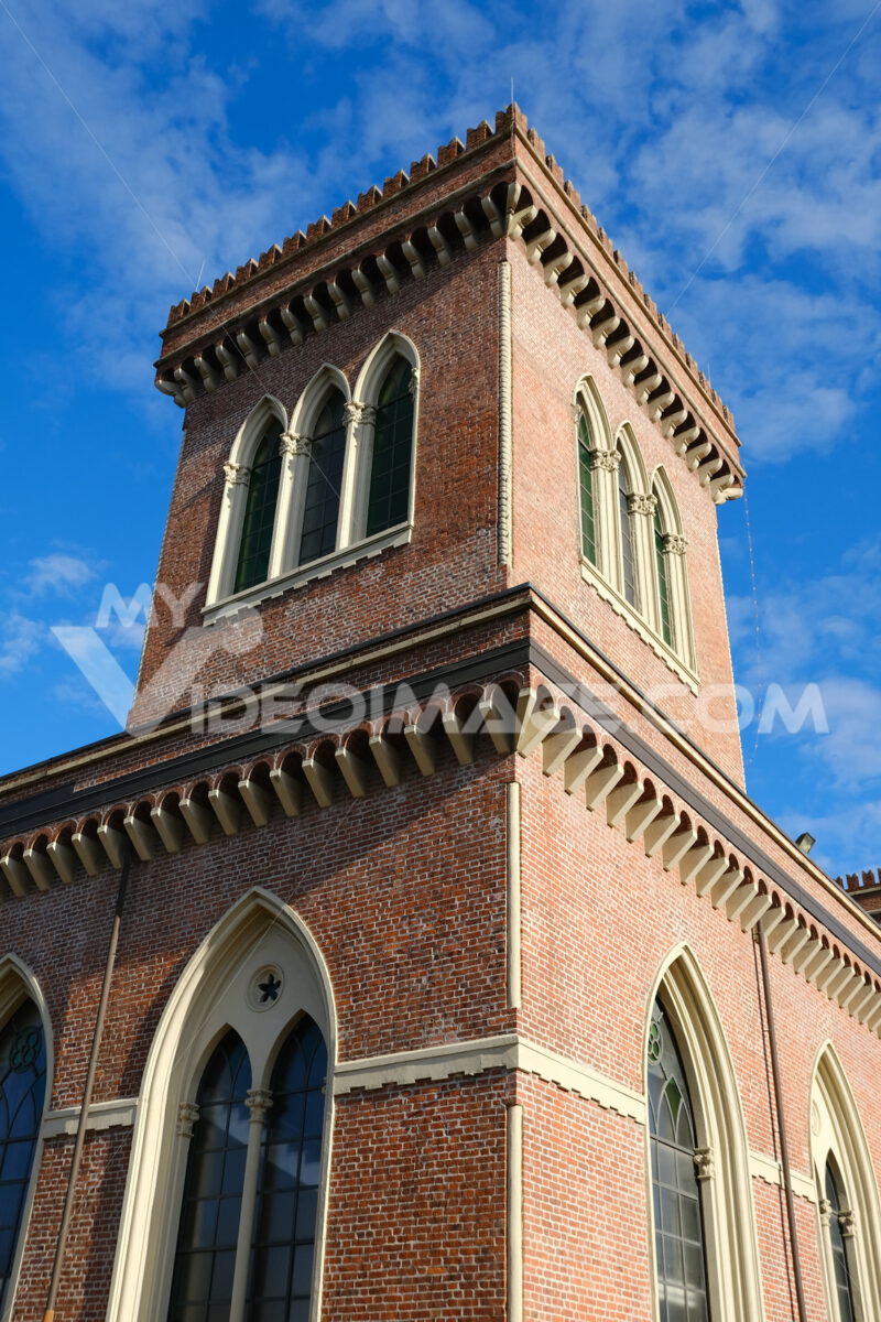Neo-Gothic tower. Textile Museum in Busto Arsizio. Neo-Gothic construction in terracotta bricks with turrets and ogival windows. Foto Busto Arsizio photo