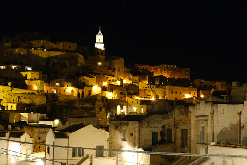 Night illumination of the ancient city of Matera. Houses made of blocks of tufa stone. - LEphotoart.com