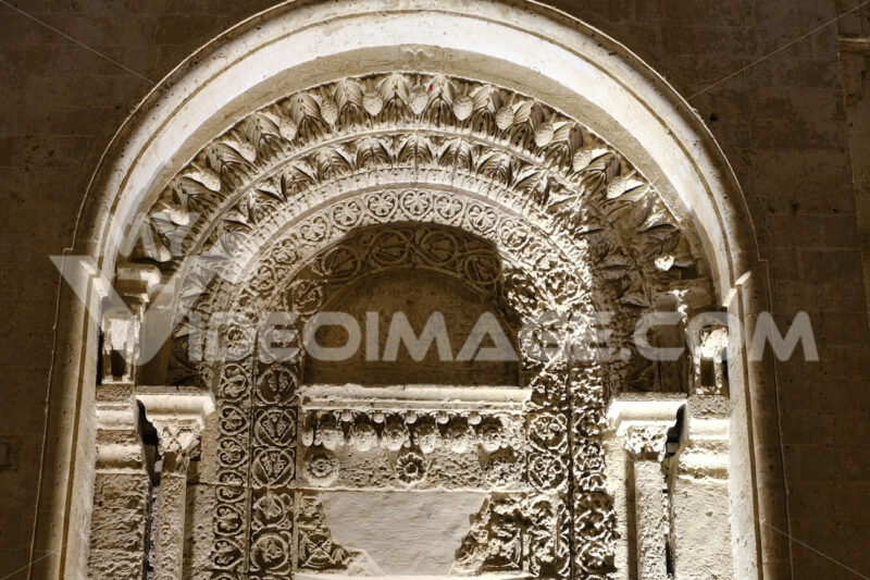 Night photo of the facade of the church of San Giovanni in Matera. Photographed with artificial lights. Detail of the portal in Arabic style. - MyVideoimage.com