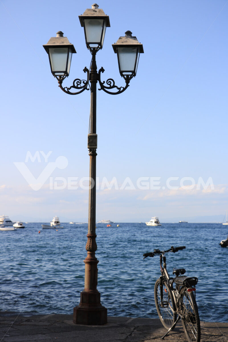 Nineteenth-century street lamp and parked bicycle. In the backgr - MyVideoimage.com
