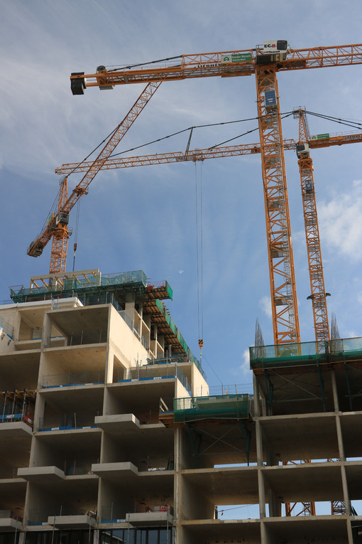 Numerous cranes for lifting materials on a construction site. Stock photo royalty free - MyVideoimage.com