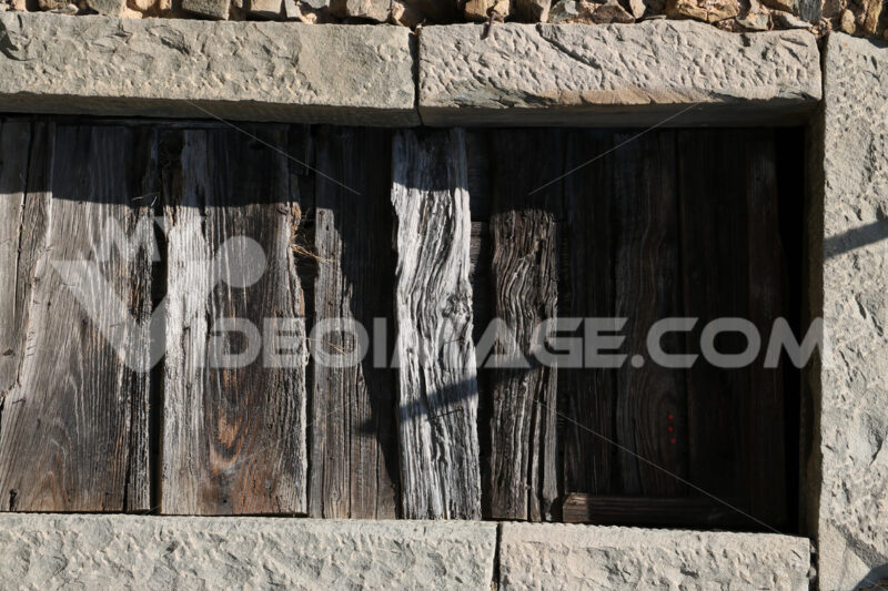 Old antique wooden door with stone portal. - MyVideoimage.com