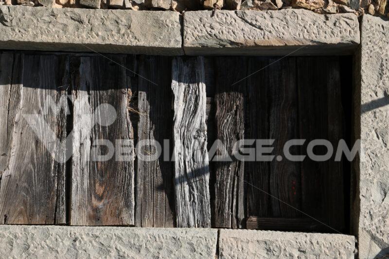 Old antique wooden door with stone portal. - MyVideoimage.com