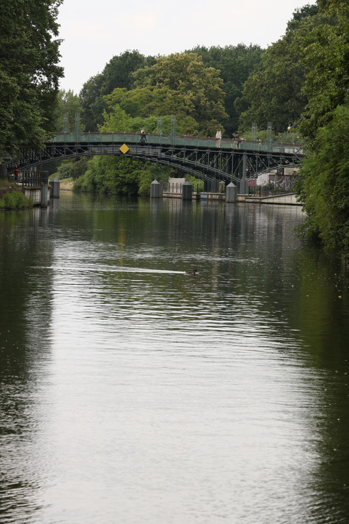Old iron bridge over the river in Berlin. At the edges a thick v - MyVideoimage.com