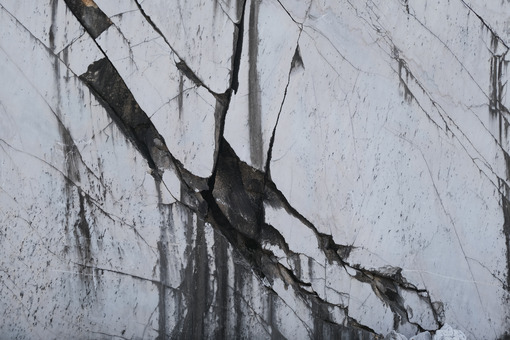 Old marble texture. Carrara white marble wall. Rough natural marble surface in a quarry. Stock photos. - MyVideoimage.com | Foto stock & Video footage