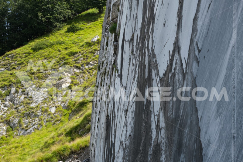 Old marble wall Marble wall in an old quarry near Carrara. Stock photos. - MyVideoimage.com | Foto stock & Video footage