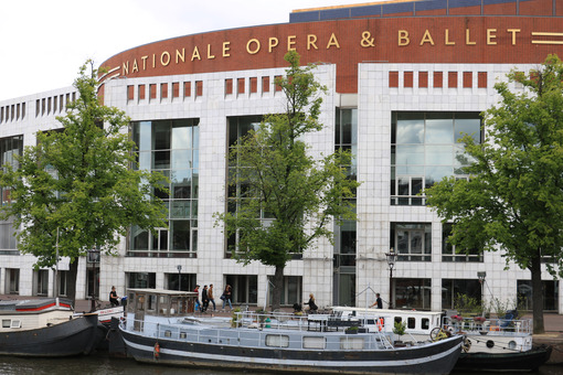 Opera house with marble and brick façade overlooking the Amstel - MyVideoimage.com