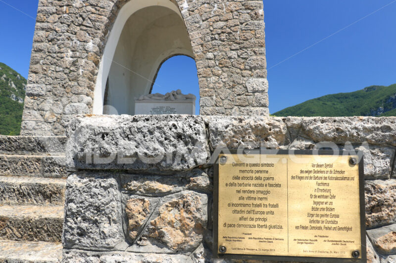 Ossuary monument of Sant'Anna di Stazzema. Nazi massacre of 12 August 1944. Plaque affixed by the presidents of the Italian and German republics. - MyVideoimage.com