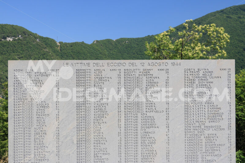 Ossuary monument of Sant'Anna di Stazzema. Nazi massacre of 12 August 1944.  Plaque with the list of victims of the massacre. - MyVideoimage.com