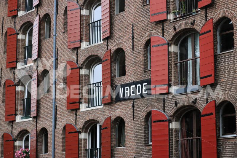 Palace windows with brick façade in Amsterdam. Vrede. - MyVideoimage.com