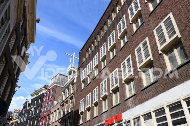 Palaces in a city street with brick wall and white windows. Blue - MyVideoimage.com
