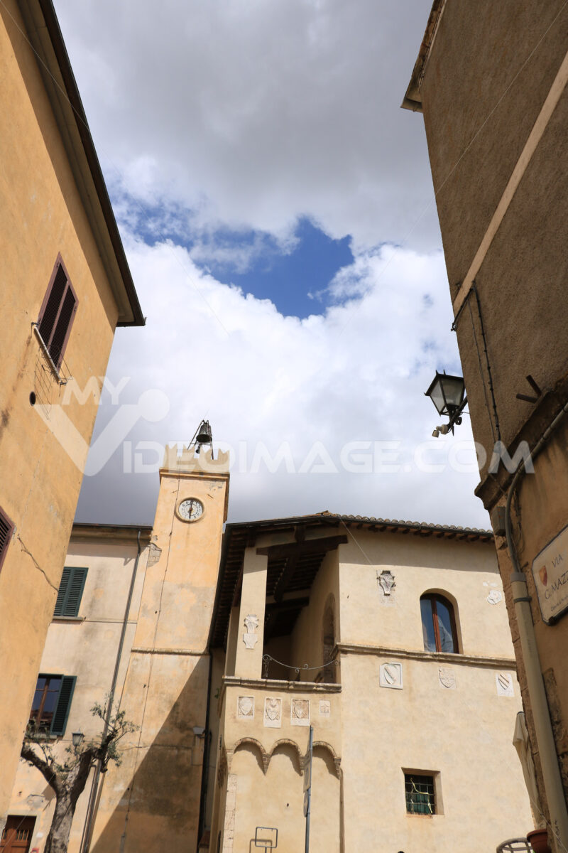 Palazzo del Podestà with bell tower and noble coats of arms and - MyVideoimage.com