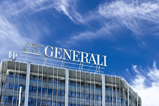 Palazzo with Assicurazioni Generali sign in Milan.  The blue sky is the background of the Italian insurance company. - MyVideoimage.com