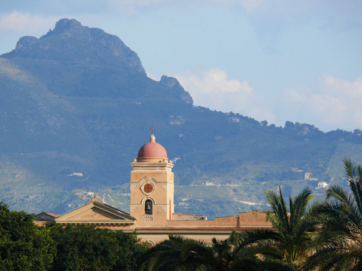 Palermo, Sicily, Italy.  Bell tower and church with mountains background. - MyVideoimage.com