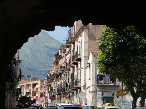 Palermo, Sicily, Italy. Popular road with mountain frond. - MyVideoimage.com | Foto stock & Video footage