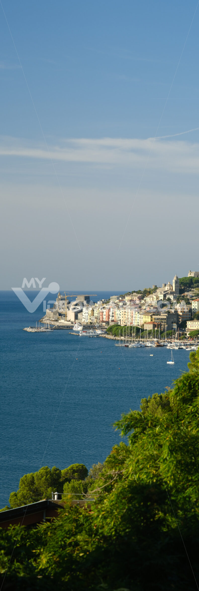 Panorama from the top of Portovenere, near the Cinque Terre, at sunrise light. The bay with the marina, the fort, the church of San Pietro. - MyVideoimage.com