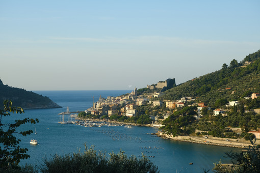 Panorama from the top of Portovenere, near the Cinque Terre, at sunrise light. The bay with the marina, the fort, the church of San Pietro. - LEphotoart.com