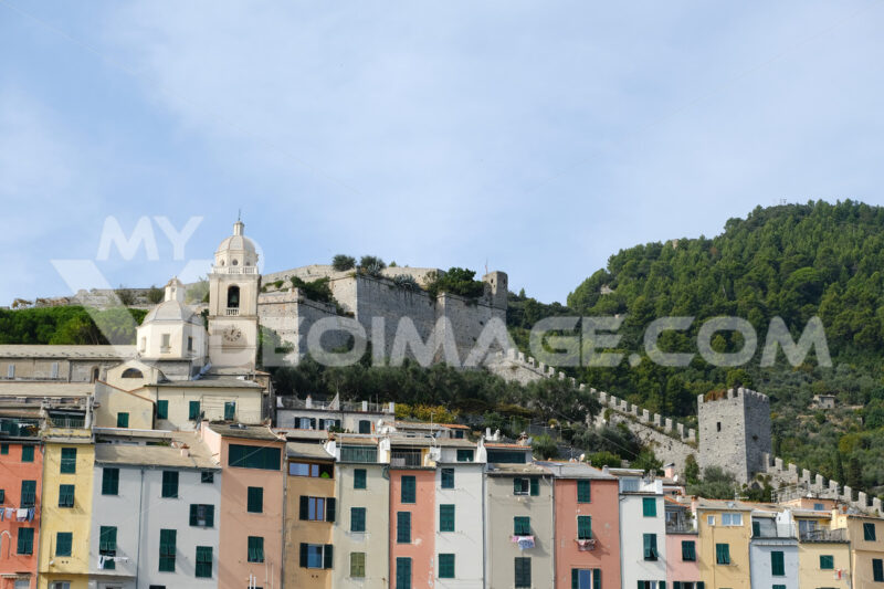 Panorama of Portovenere near the Cinque Terre with typical colorful houses. The church, the casttle with  towers and walls. - MyVideoimage.com