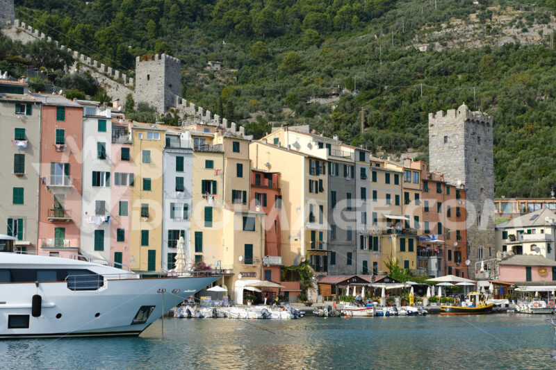 Panorama of Portovenere near the Cinque Terre with typical colorful houses. The church, the towers of the walls and the marina with boats and yachts. - MyVideoimage.com