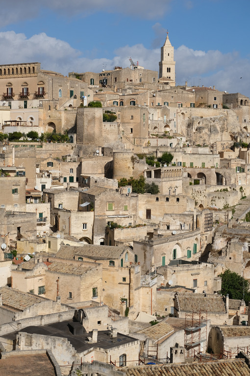 Panorama of houses and of the Sassi of Matera with roofs and streets. Blue sky with - LEphotoart.com
