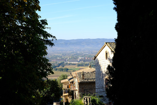 Panorama of the Assisi countryside with churches, houses and trees. From the top of the city you can enjoy a splendid panoramic view of the valley. - MyVideoimage.com