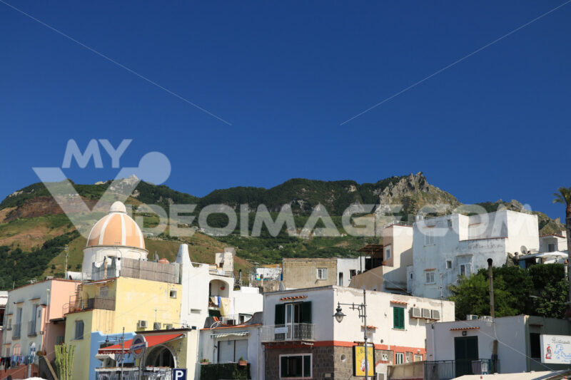 Panorama of the town of Forio d'Ischia, near Naples. 	Dome of the church of San Gaetano. The mountain and the blue sky. - MyVideoimage.com