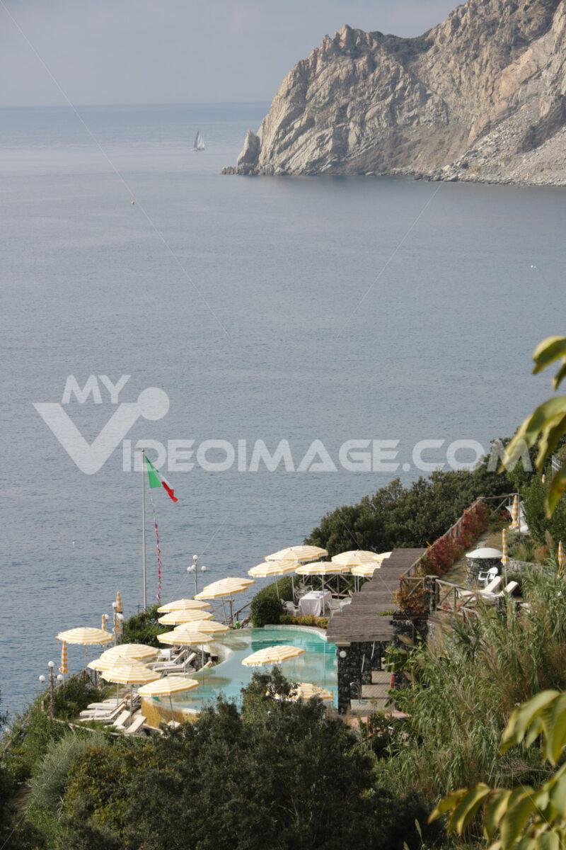Panorama with pool and umbrellas in a resort in Monterosso al Mare in the Cinque Terre. - MyVideimage.com