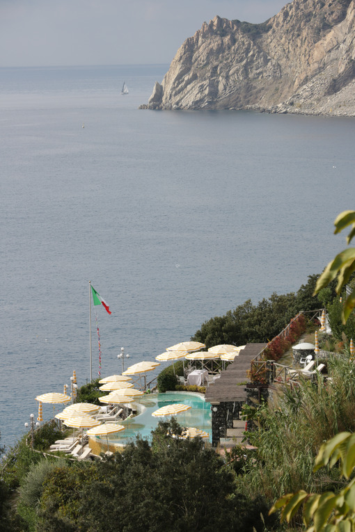 Panorama with pool and umbrellas in a resort in Monterosso al Mare in the Cinque Terre. - MyVideimage.com