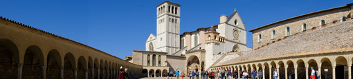 Panoramic photograph of the square and of the church of San Francesco in Assisi with the side arcades. - LEphotoart.com