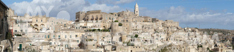 Panoramic photography of the houses and the Sassi of Matera with the roofs and the streets. Blue sky with - MyVideoimage.com