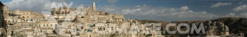 Panoramic photography of the houses and the Sassi of Matera with the roofs and the streets. Blue sky with - LEphotoart.com