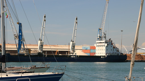 Panoramic view of the port. A Cargo ship and a ferry are anchore - MyVideoimage.com
