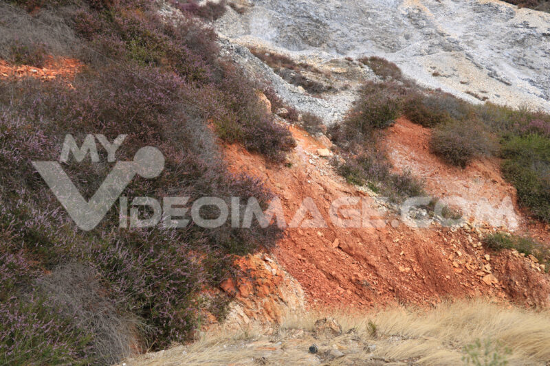 Parco delle Biancane. Geothermal park with iron red colored rock - MyVideoimage.com