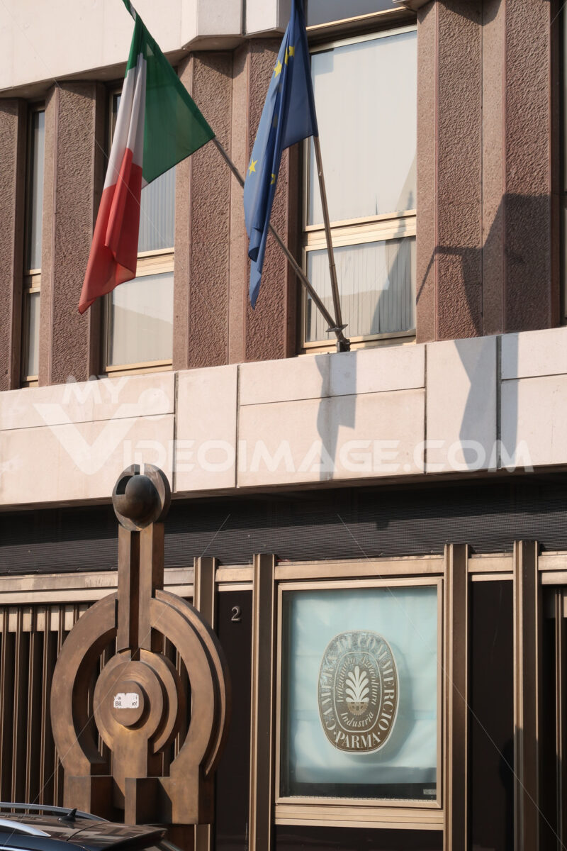 Parma Chamber of Commerce. Palace with bronze sculpture and Italian and Euripean flags. - MyVideoimage.com