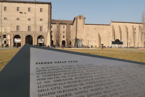 Peace Square in Parma. Steel table with engraved characters. Palazzo della Pilotta and gardens in winter. - MyVideoimage.com