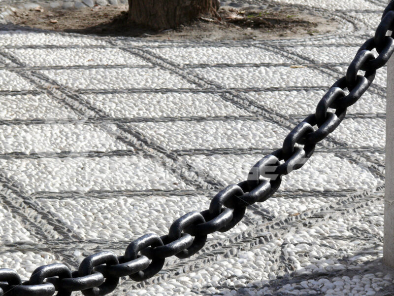 Pebble marble floor and large iron chain. - MyVideoimage.com