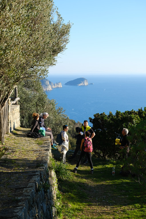 People on a Sunday trip on the paths of the Cinque Terre in Liguria. Background with Palmaria island. Stock free photo - LEphotoart.com