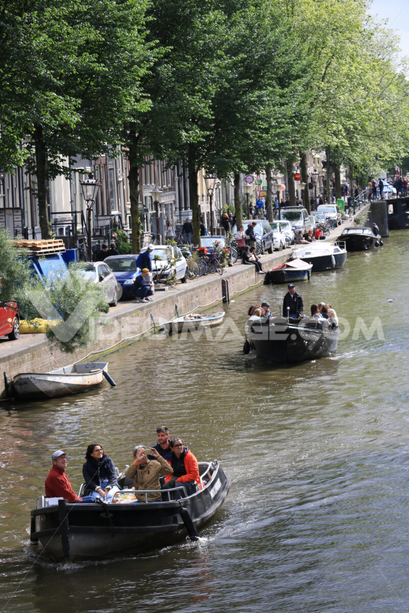 People on a tourist boat trip on the canals of the city of Amsterdam - MyVideoimage.com