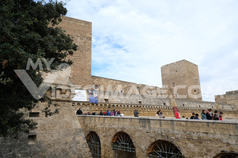 People walking on the bridge of the Swabian castle of Bari. The fort is built entirely with stone walls. - MyVideoimage.com