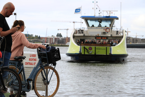 People with bicycles waiting for the ferry. - MyVideoimage.com