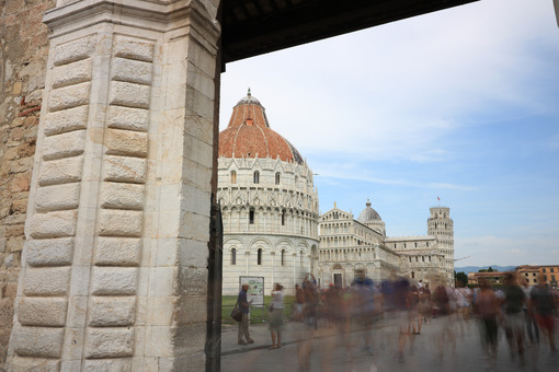 Piazza dei Miracoli of Pisa seen from a door of the city walls. The tower and the cathedral can be seen from the white marble portal. - LEphotoart.com