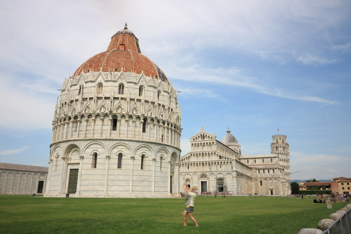 Piazza dei Miracoli of Pisa. People photograph the monuments and the leaning tower. - MyVideoimage.com