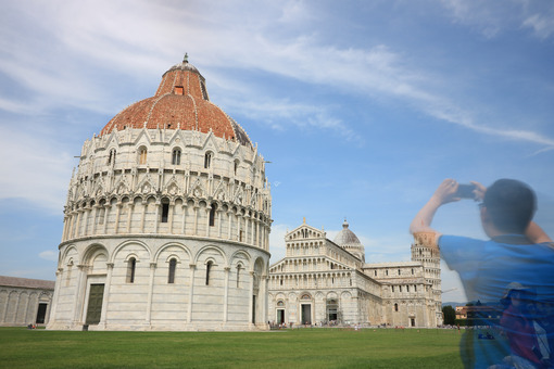 Piazza dei Miracoli of Pisa. People photograph with smartphone the monuments and the leaning tower. - LEphotoart.com